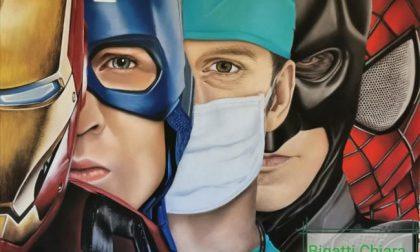Coronavirus: un'opera trasforma in supereroi infermieri e medici